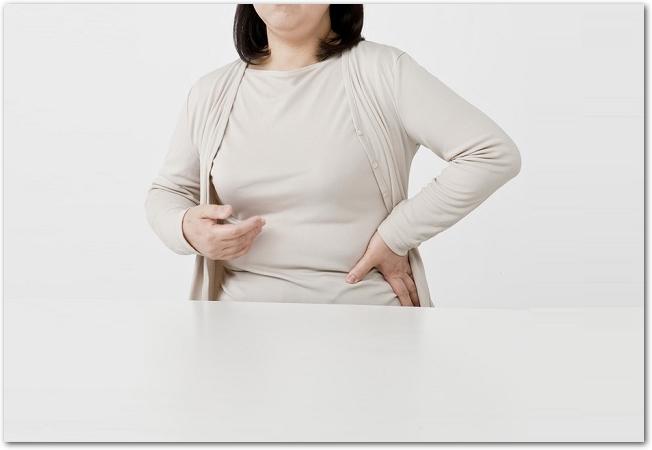 お正月太りを気にする女性